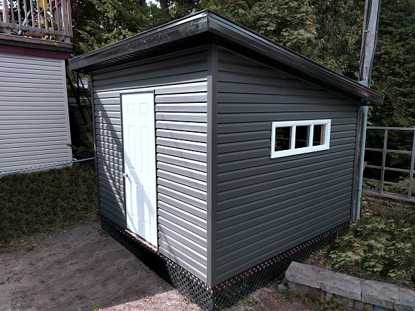 10x10 Modern Shed, overhang and soffits, black lattice skirting, large window - Summit Sheds, Ottawa