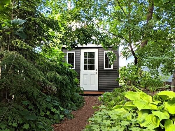 10x10 with 1/2 light door and premium dark siding - yard storage