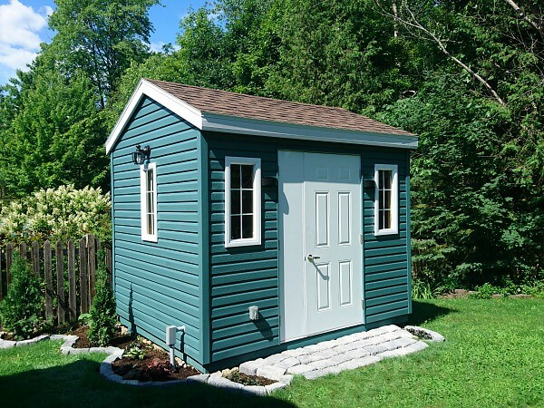 8x10 wood structure, green vinyl siding, door and a half, additional window