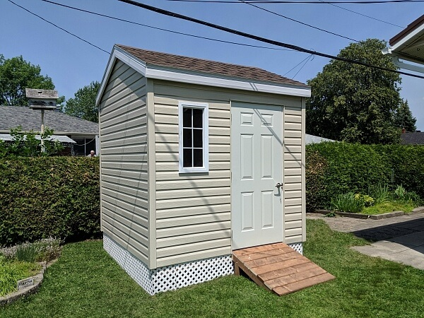 8x8 small shed, steel door, white lattice skirting, ramp