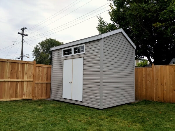 9x12 storage shed with 9' walls, double steel doors, transom windows