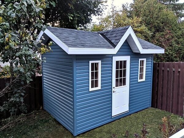 Summit Sheds, Ottawa - 8x12 Victorian shed, blue premium vinyl siding, 1/2 light door, soffits and overhang